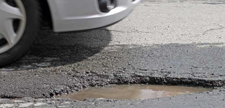 What to do if your car is damaged by a pothole